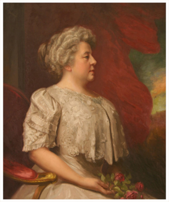 <p>Dola Mae Litzenburg. <em>Portrait of Mrs. Horace C. Henry</em>. 1900-1910. Oil on canvas. Henry Art Gallery, Horace C. Henry Collection, 26.165.<br /></p>  <p><p>With the billowing red curtain and the throne-like chair, as well as her formal dress and stiff posture, this portrait of Mrs. Horace C. Henry (née Susan Elizabeth Johnson) references traditions of royal portraiture that were adopted by the wealthy, and checks most of Freeland's boxes.</p></p>