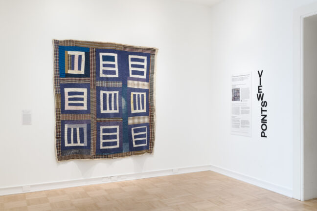 """<p>Mary L. Bennett, <em>""""Housetop""""&mdash;nine-block variation</em>, c. 1975. Cotton, denim, cotton/polyester blend, cotton knit. Henry Art Gallery, purchased with funds from William L. True and gift of the Souls Grown Deep Foundation, 2020.1. Installation view of <em>A Gee's Bend Quilt by Mary L. Bennett</em>, 2021, Henry Art Gallery, University of Washington, Seattle. Photo: Jueqian Fang. </p>  <p><p></p></p>"""