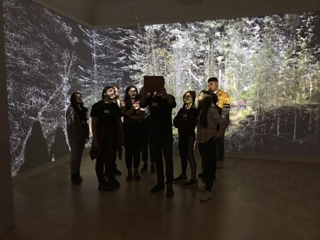 <p>Exhibiting artist Abe Avnisan showsmembers of the Henry Teen Art Collective his installation,<em>Sin Sol, Forest Memory</em>, a collaboration with artist micha cárdenas<em>.</em> Photo: Katrina Herzog.<br /></p>