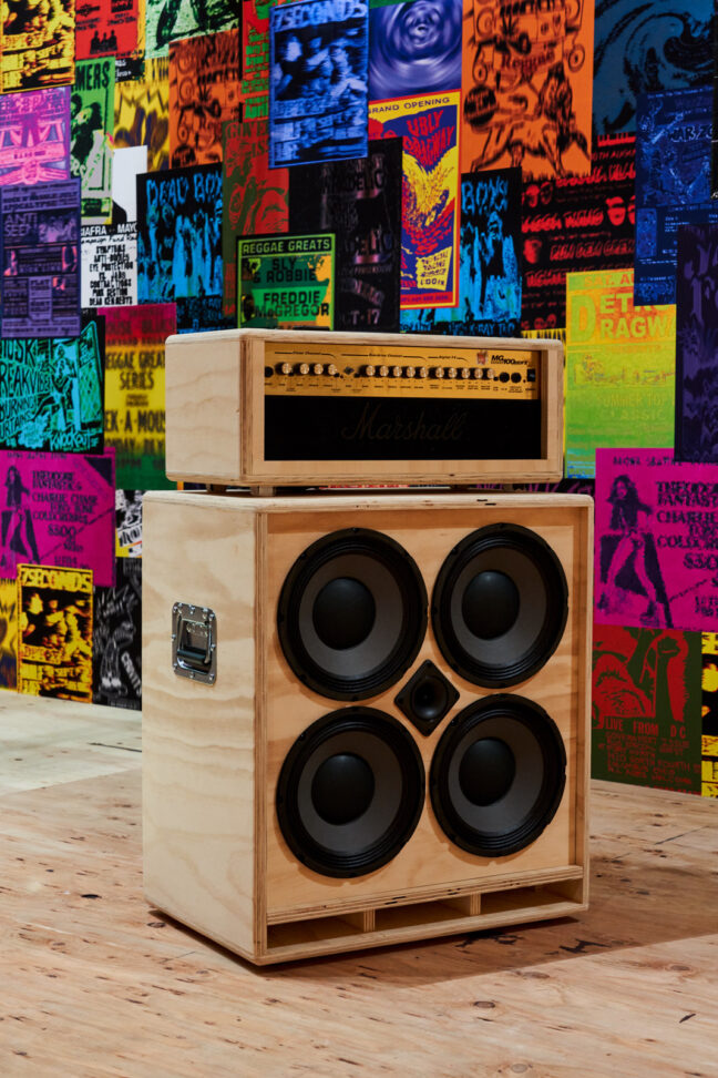 <p>Gary Simmons, <i>Garage Band </i>[detail], 2021. Structure: wood, plywood, printed matter, glue, and hardware; sound equipment: wood, plywood glue, metal, sound, and electric; shelf: wood, glue, and hardware; Christmas lights: vintage electric string lights; foil box: cardboard, tape, plaster, and foil; gas tank: metal cast; helmet: found object; milk metal crate: found object, plastic, and galvanized steel; four plaster boxes: cardboard, tape, and plaster; small engine: foam, glue, plaster, and foil; string lights: vintage electric string lights, 28 glass bulbs. Courtesy of the artist. &nbsp;Installation view of <i>Gary Simmons: The Engine Room</i>, 2021, Henry Art Gallery, University of Washington, Seattle. Photo: Jonathan Vanderweit.</p>