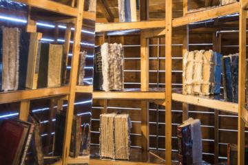 <p>Edgar Arceneaux. <em>Library of Black Lies</em>. 2016. Wood, mirrored glass, mylar, newspaper, hard-bound books, sugar crystals, lighting fixtures, audio component. [Installation view, Yerba Buena Center for the Arts, 2017]. Courtesy Yerba Buena Center for the Arts. Photo: Charlie Villyard.<br /></p>