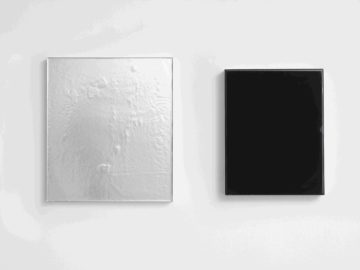 <p>Carrie Yamaoka.<i> recto/verso. </i>2014.Reflective black vinyl, urethane resin, and mixed media on wood panel. Courtesy of the artist.</p>
