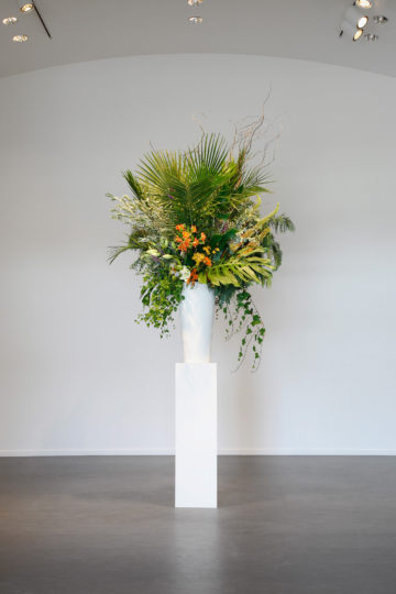 <p>Willem de Rooij. <i>Bouquet XI.</i> 2014. White fiberglass vase, plinth, flower arrangement of allergenic flowers and foliage originating from the Middle East, second version created by Nisha Kelen, Seattle. Courtesy of the artist, Petzel Gallery, New York, and Regen Projects, Los Angeles. [installation view] 2015. Henry Art Gallery, University of Washington, Seattle. Photo credit: Mark Woods Photography.</p>